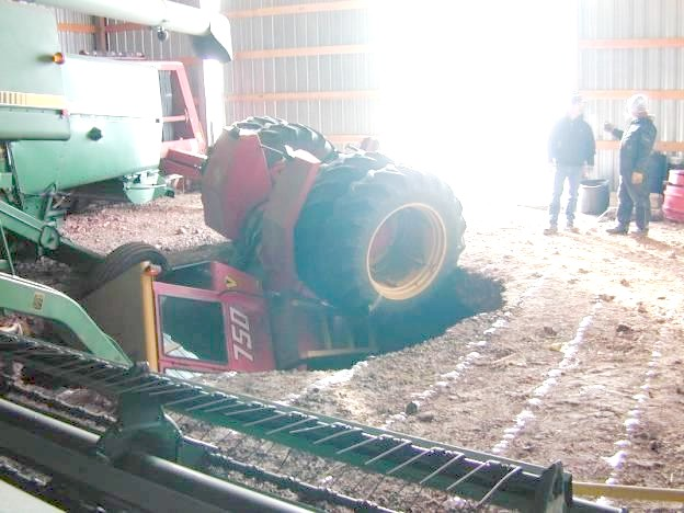 Farm equipment down a hole